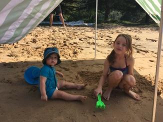 Finn and Romi play on the beach